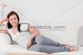 Cute woman lying on her sofa