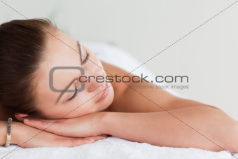 Close up of a young brunette lying on a massage table