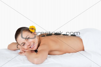 Young woman having a LaStone therapy