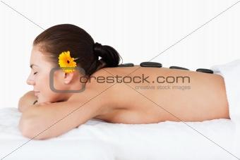 Beautiful woman having a hot stone massage