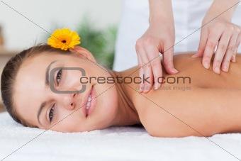 Beautiful woman having a shoulder massage