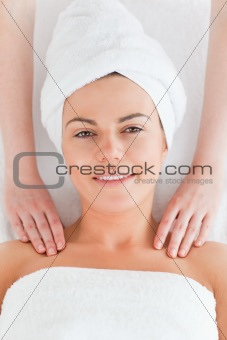 Beautiful woman enjoying a shoulder massage