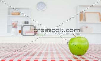 An apple on a tablecloth