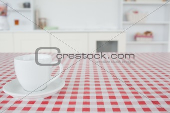 A cup of tea on a tablecloth