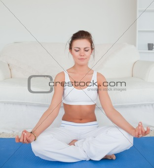 Calm brunette practicing yoga