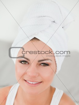 Close up of a woman with the hair wrapped into a towel