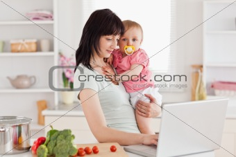 Charming woman holding her baby in her arms