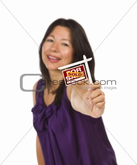 Attractive Multiethnic Woman Holding Small Sold For Sale Real Estate Sign in Hand Isolated on White Background.