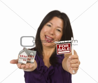 Multiethnic Woman Holding Small For Sale Real Estate Sign and House in Hand Isolated on White Background.
