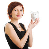woman holding piggy bank against white background