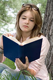 Teenages girl reading book