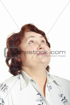 Mature woman  looking up