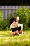 reading e-book in the park