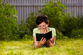 reading e-book in the park