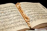 Koran book and rosary.