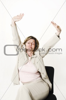 business woman stretching on chair