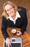 Young Business Woman drinking coffee and doing work (smiling)