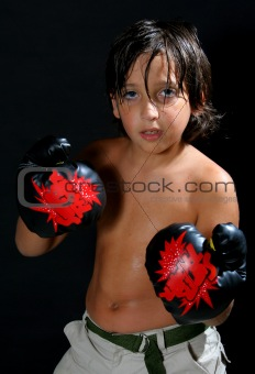 Boy boxing over a black background