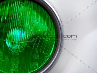 Green classic car headlight