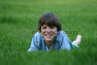 Boy Laying in Grass