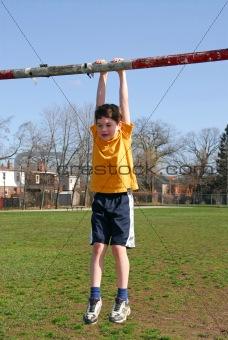 Boy hanging on