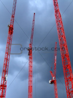 Four red cranes