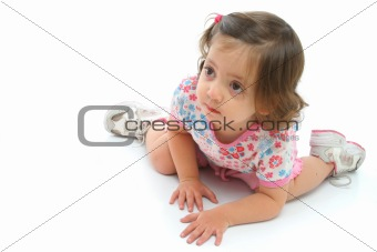 Little girl on the floor with a beautiful expression