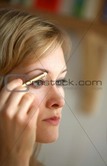 Modern Woman Applying Makeup