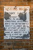 Old Prison Visiting Hours sign