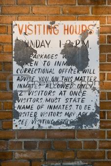 Old Prison Visiting Hours sign