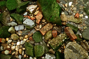 Green rocks, red bricks and stones