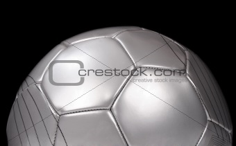 Close up of a silver football on black