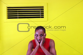 Black man in a yellow room