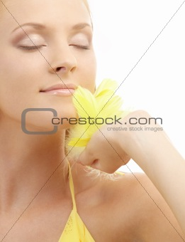 portrait of girl with yellow feathers