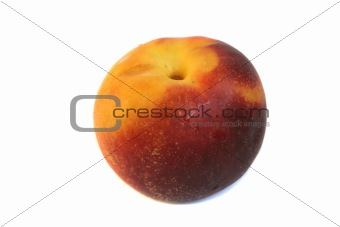 One tasty ripe peach is isolated on a white background