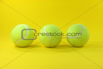 three yellow balls