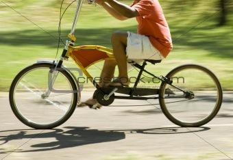 Boy in stylish bicycle.