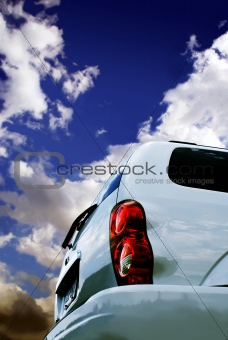 Back of car against dramatic sky