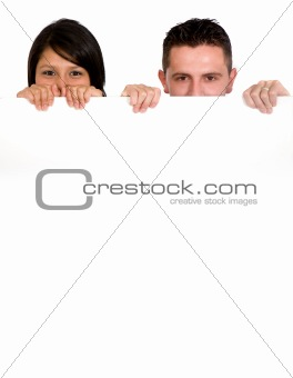 couple holding a white billboard