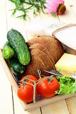 Picnic basket, bread, cheese and vegetables
