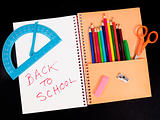 School supplies with spiral notebook
