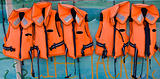 Row of orange life jackets