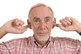 Old man with fingers in ears