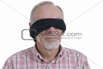 Senior man with blindfold isolated on white