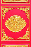 golden dragon decorated on red wood