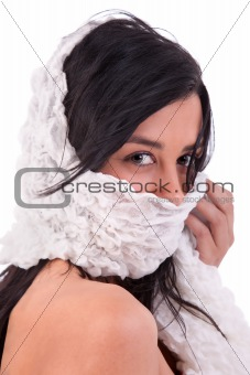 beautiful woman covering her face with a white handkerchief, isoated on white, studio shot