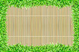 grass frame on bamboo texture background