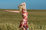 blonde beauty in wheat field