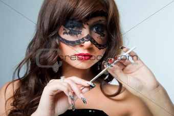 attractive young brunette girl with silver mouthpiece on blue