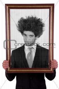 man holding a decorative frame and standing inside it on black and white, isolated on white, studio shot